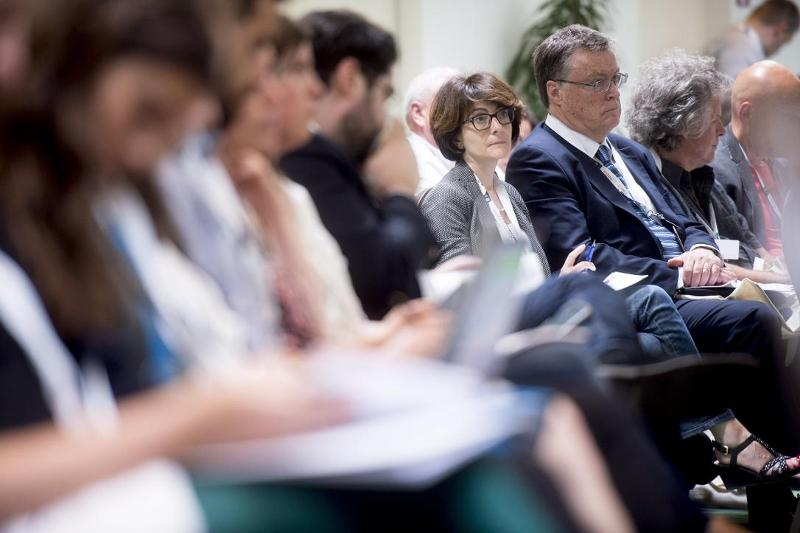 In the public, spot Sylvie Fodor as attendant to the conference